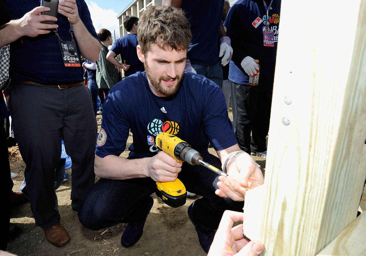 Love wields a drill during the NBA Cares All-Star Day of Service.