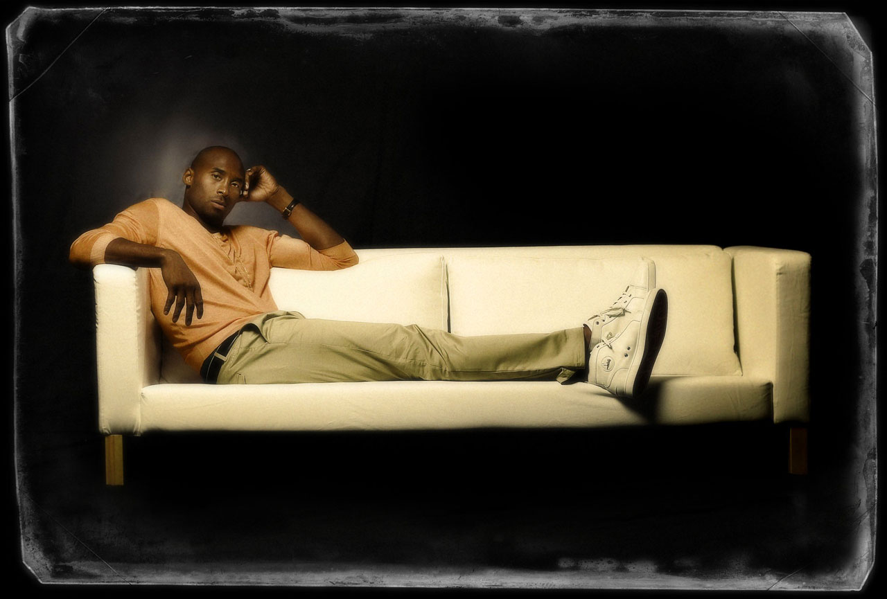 Kobe relaxes on a couch during this photo shoot in 2014.
