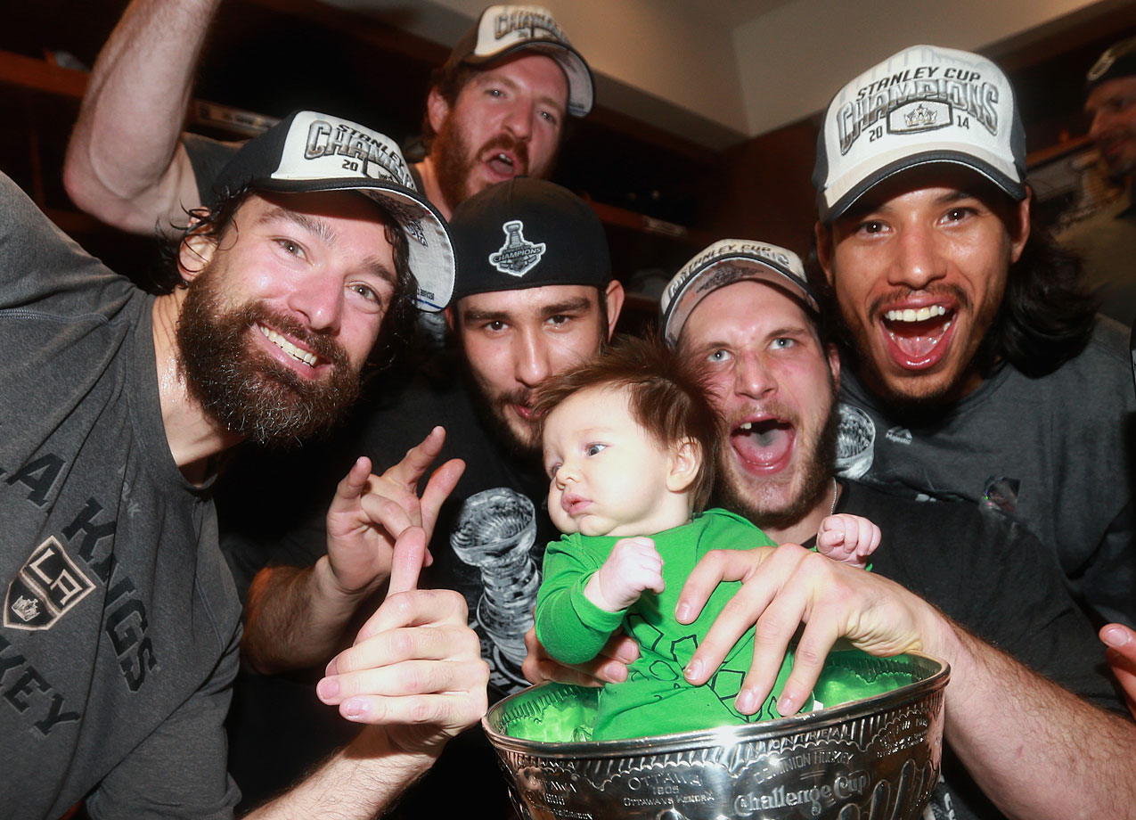 Son of Los Angeles Kings left wing Kyle Clifford (2nd from right), posing with (left to right) Justin Williams, Colin Fraser, Slava Voynov and Jordan Nolan.