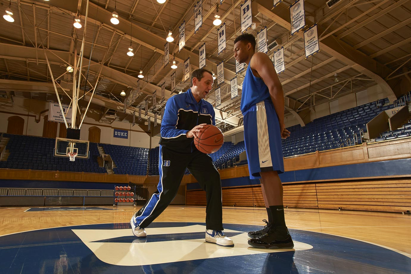 Mike Krzyzewski and Jabari Parker pose during a photo shoot at Cameron Indoor Stadium in 2014.