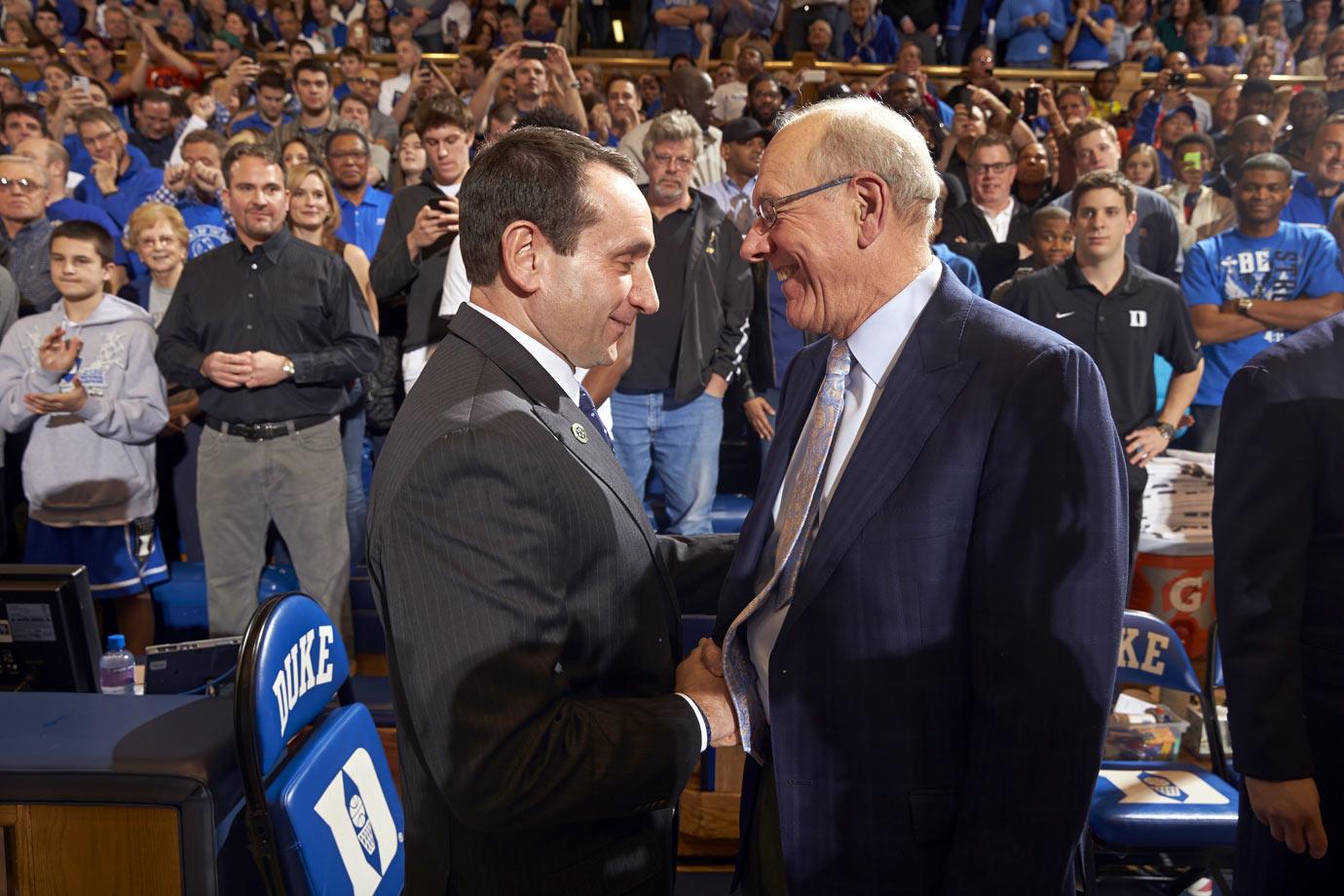 Mike Krzyzewski shakes hands with Jim Boeheim before a game at Cameron Indoor Stadium in 2014.  Duke defeated Syracuse 66-00.