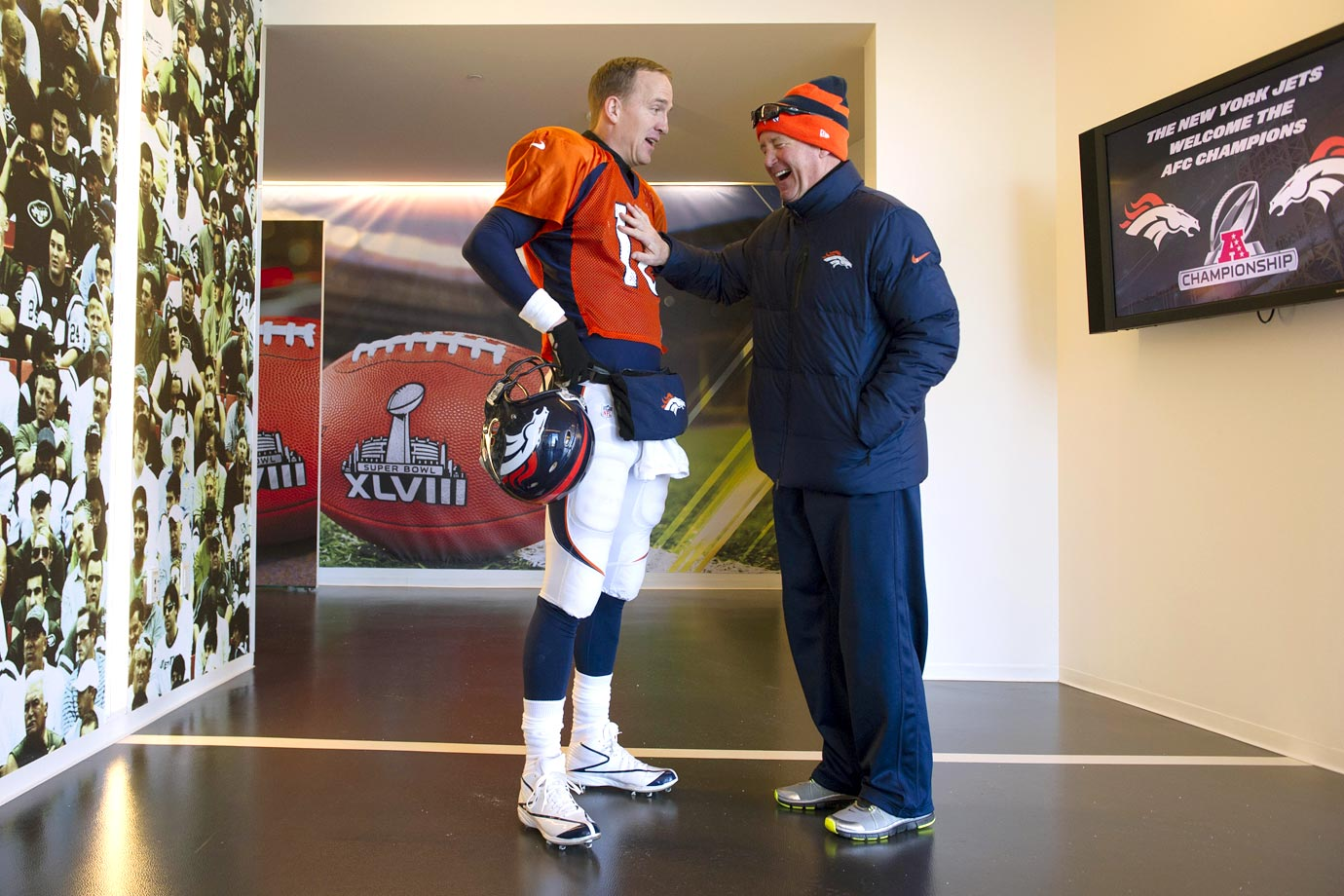 Peyton Manning gets a laugh out of Broncos head coach John Fox prior to Super Bowl XLVIII at MetLife Stadium in East Rutherford, N.J.