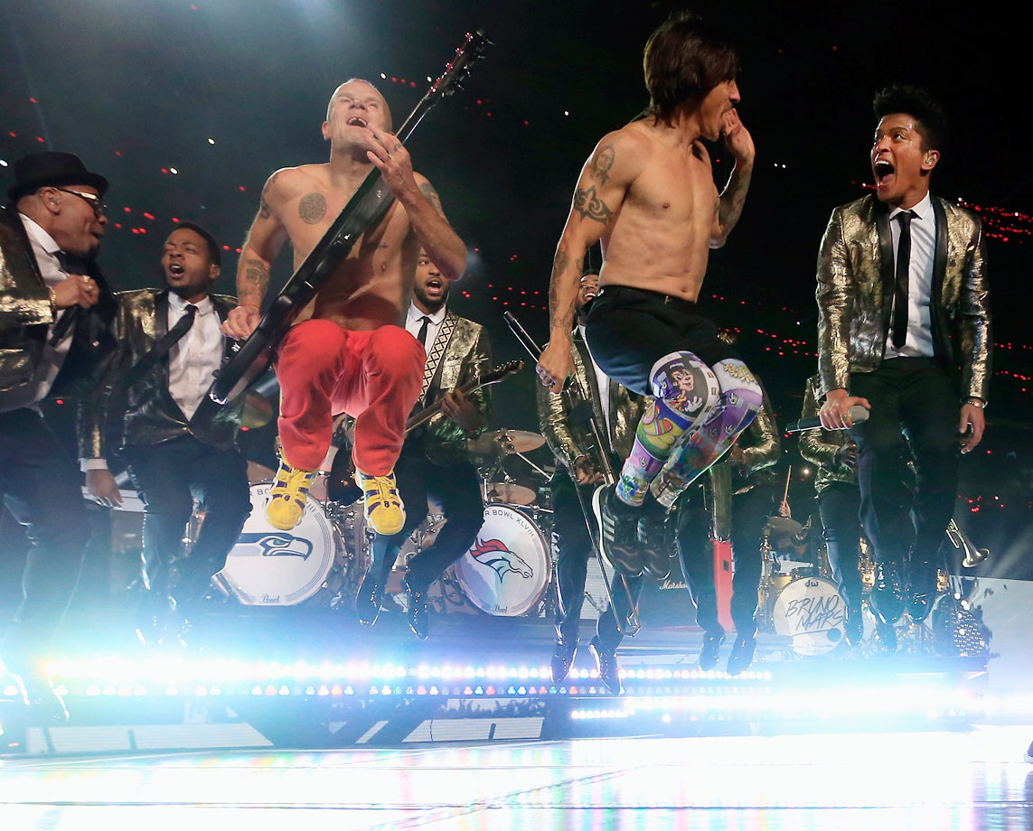 "Despite the Seahawks holding a commanding 22-0 lead at the half, a record 115.3 million viewers tuned in for Bruno Mars' performance. Mars chose three songs for his halftime show, belting out ""Treasure,"" ""Locked Out of Heaven"" and ""Just The Way You Are,"" with the Red Hot Chili Peppers joining him to perform their 1991 hit ""Give It Away."""