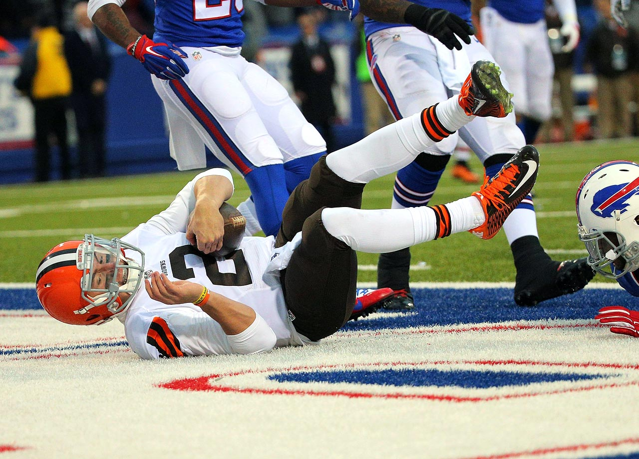 Johnny Manziel scores his first regular season NFL touchdown on a 10-yard run against the Buffalo Bills in the fourth quarter on Nov. 30, 2014 at Ralph Wilson Stadium in Orchard Park, N.Y.