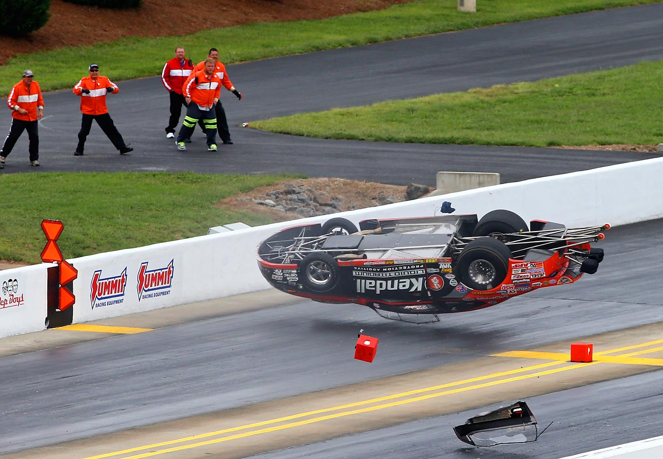 NHRA driver V. Gaines flips during the first round of the Carolina Nationals.