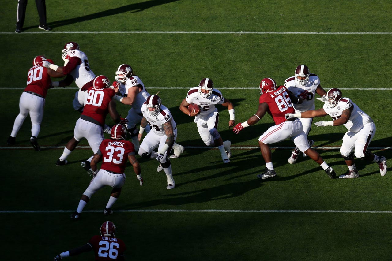 Dak Prescott (15) of Mississippi State runs  in the first half against Alabama.
