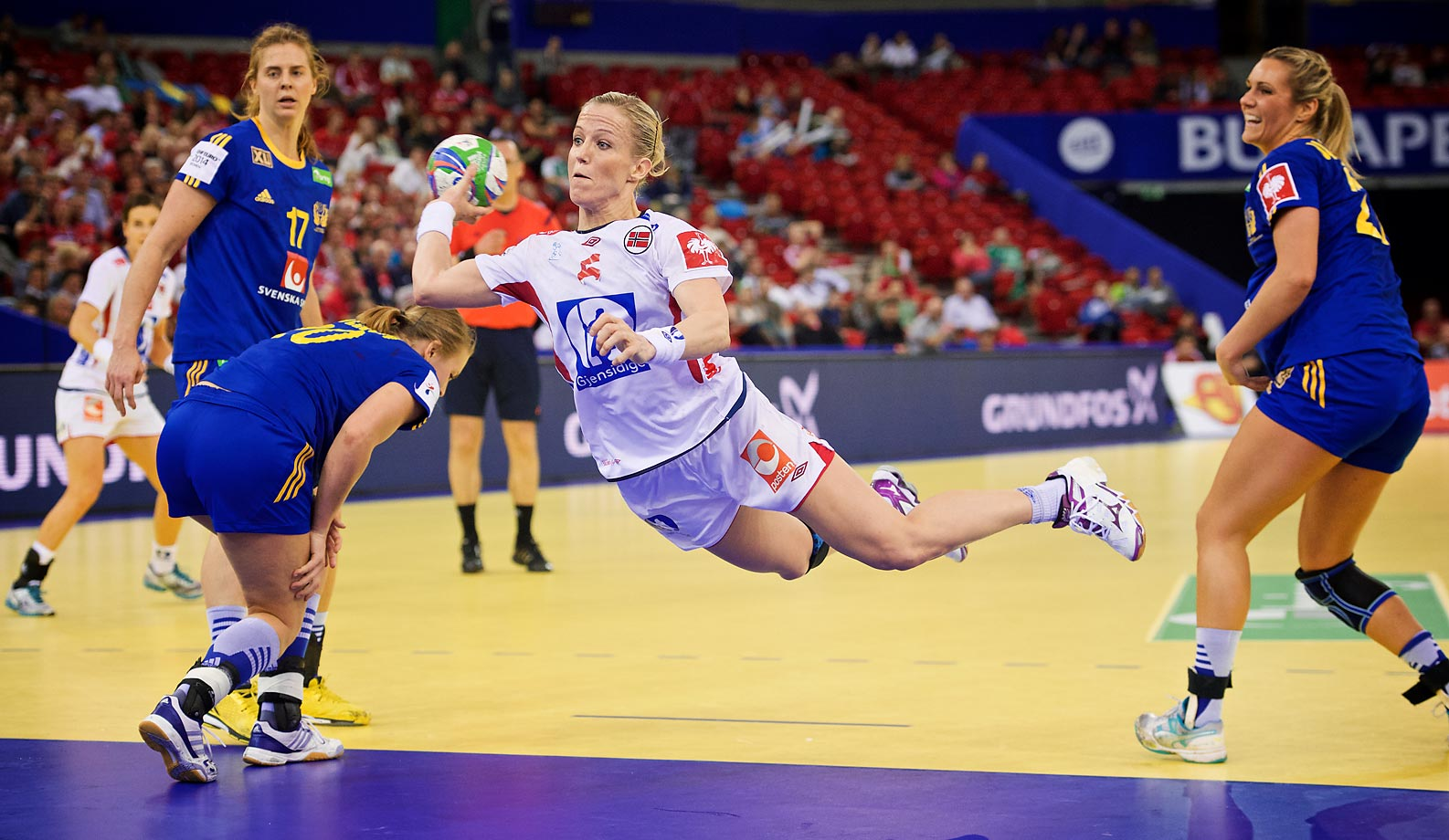 Norway's Heidi Loke  scores during a semi-final game against Sweden.