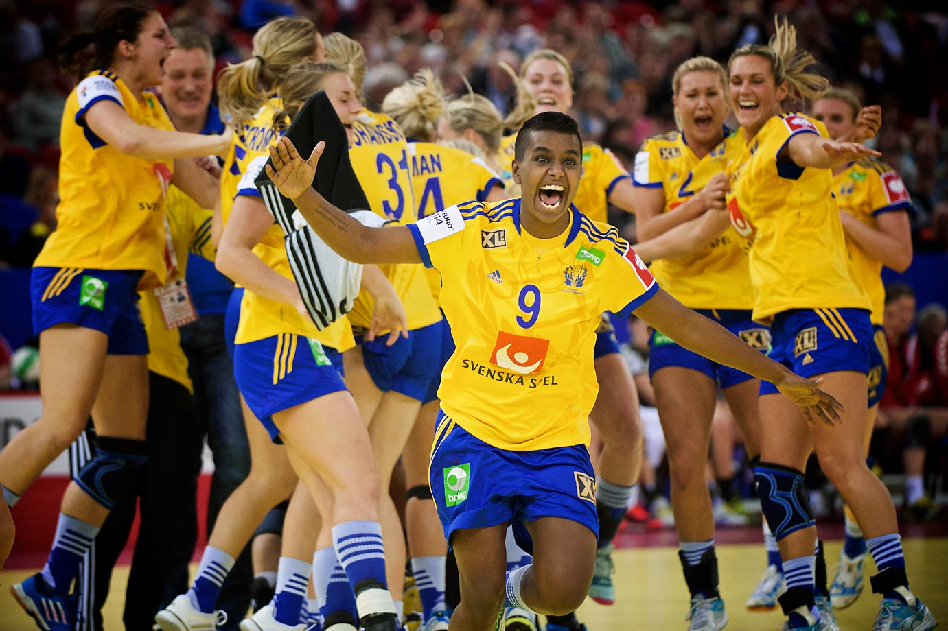 Sweden's Louise Sand celebrates with her team after winning the 3rd place game.