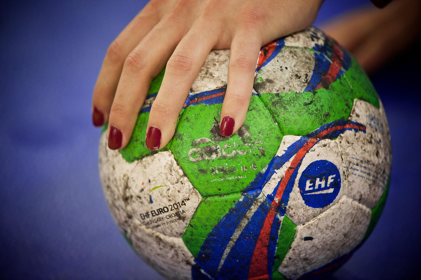 A member of Spain's women's handball team sports red fingernails before the championship match.
