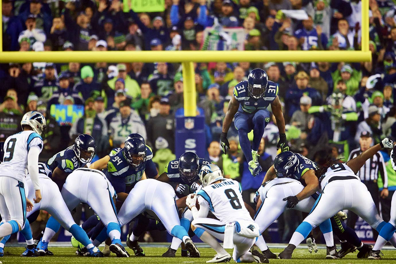 The Seahawks postseason started with a 31-17 win over Carolina. Russell Wilson threw for three touchdowns, but Kam Chancellor was the star, jumping over linemen on field goal attempts and returning an interception 90 yards for a touchdown.