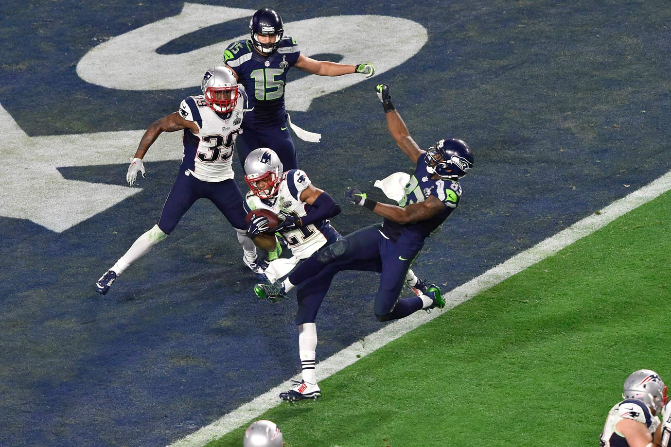 New England Patriots cornerback Malcolm Butler intercepts a pass intended for Seattle Seahawks wide receiver Ricardo Lockette on 2nd and goal with 26 seconds left in the game. Butler took the ball, and the game, away. The Pats won 28-24.
