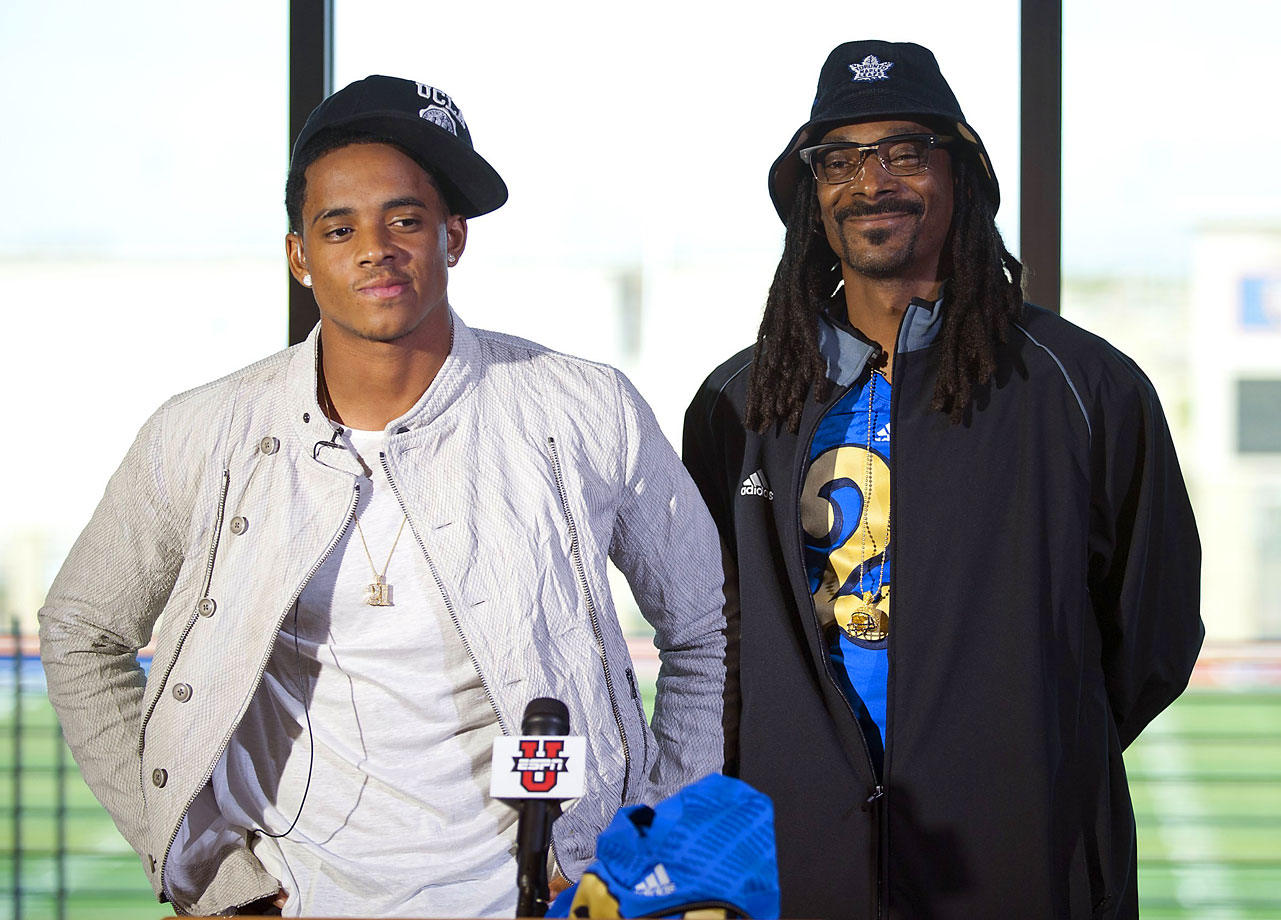 Snoop Dogg stands beside his son Cordell Broadus during a press conference announcing his commitment to UCLA on Feb 4, 2015 at Bishop Gorman High School in Las Vegas.