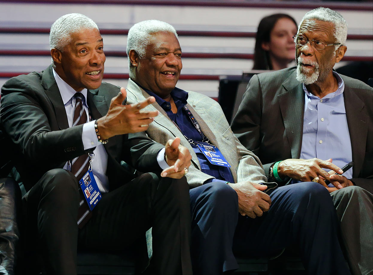 Julius Erving, Oscar Robinson and Bill Russell talk during the NBA All-Star Saturday Slam Dunk contest in New York City.
