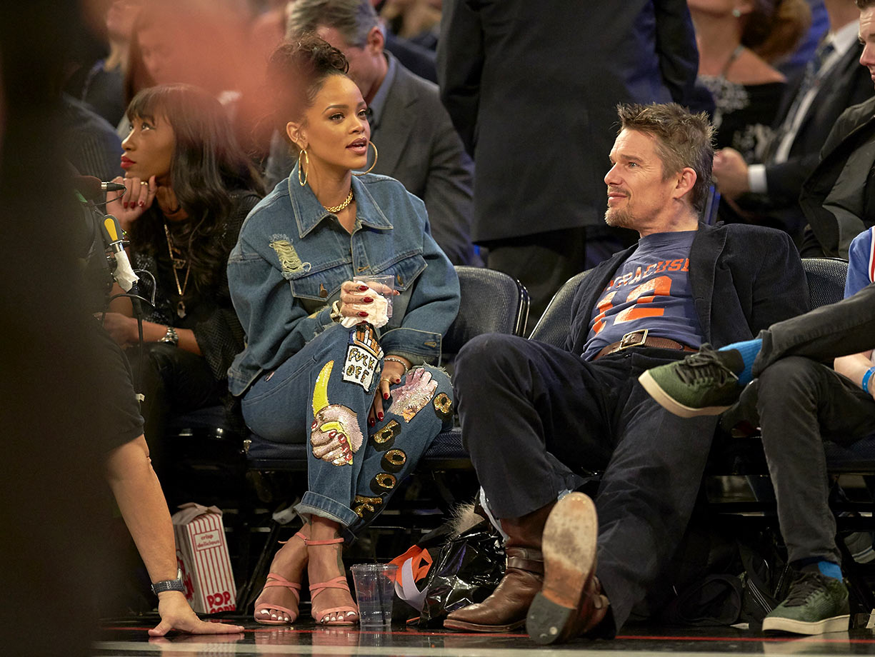 Rihanna and Ethan Hawke sit courtside during the NBA All-Star Game on Feb. 15, 2015 at Madison Square Garden in New York City.