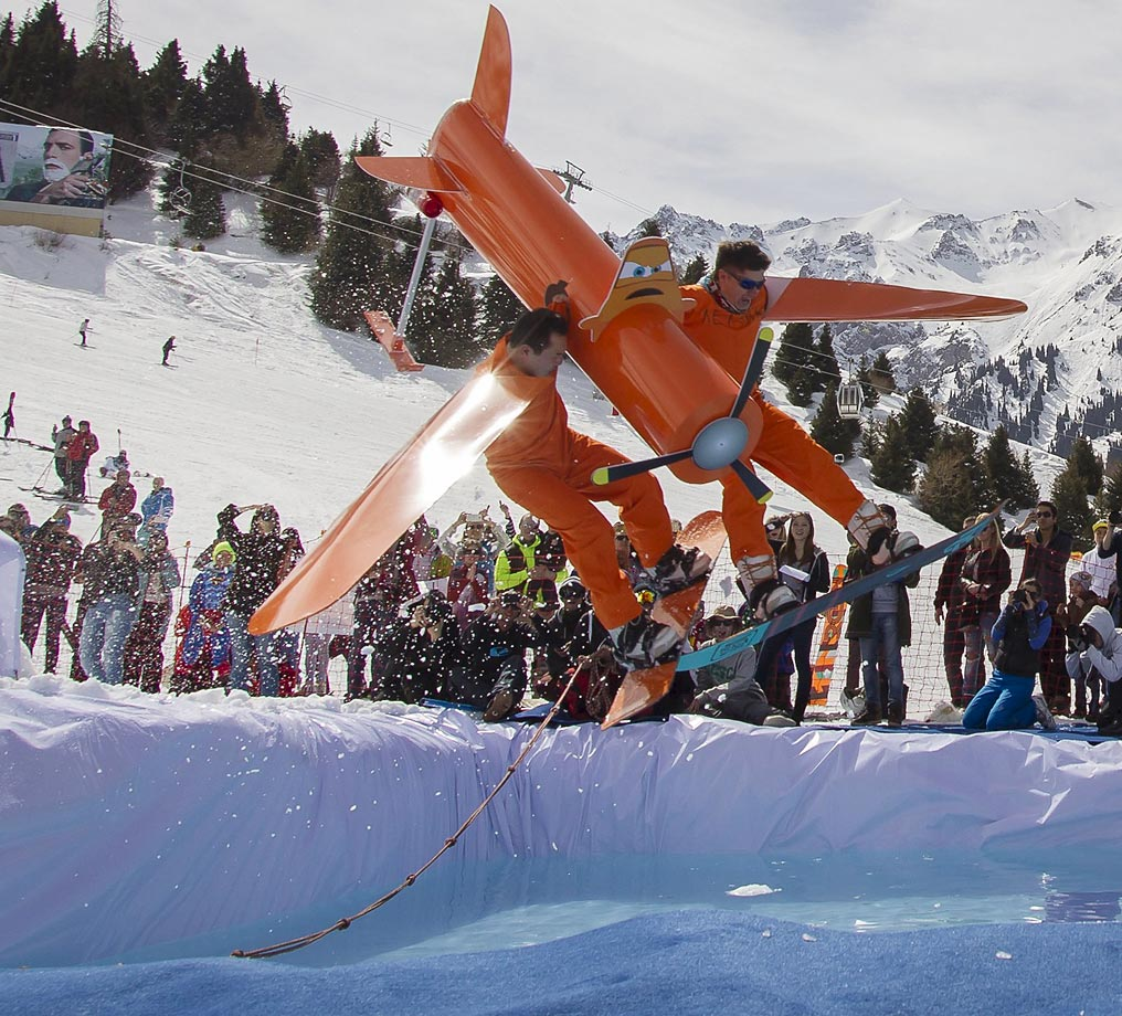 Snowboarders perform with a homemade craft during the Red Bull Jump and Freeze competition.