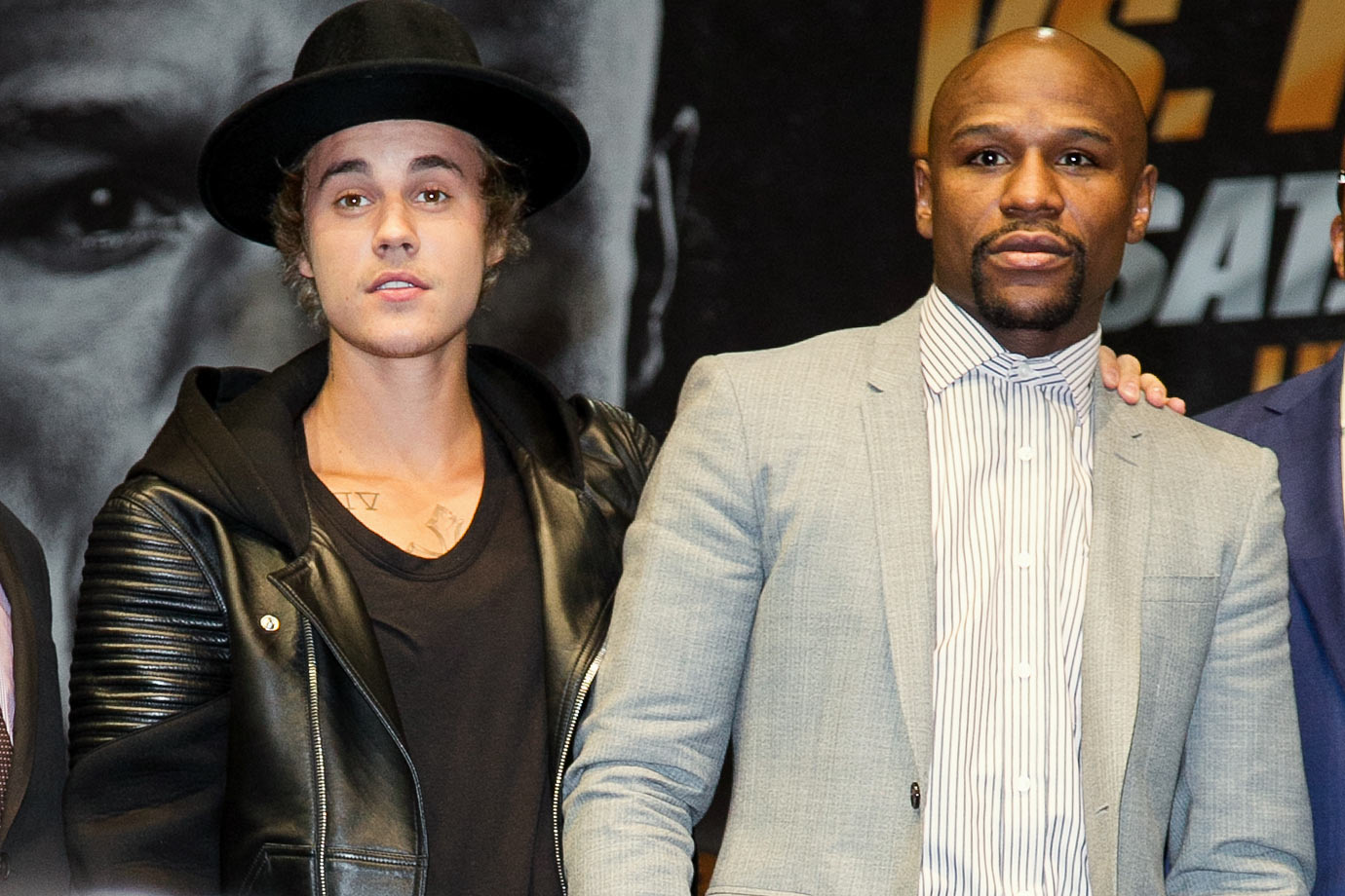 Justin Bieber poses with Floyd Mayweather Jr. during the Floyd Mayweather vs. Manny Pacquiao Press Conference on March 11, 2015 at Nokia Theatre L.A. Live in Los Angeles.