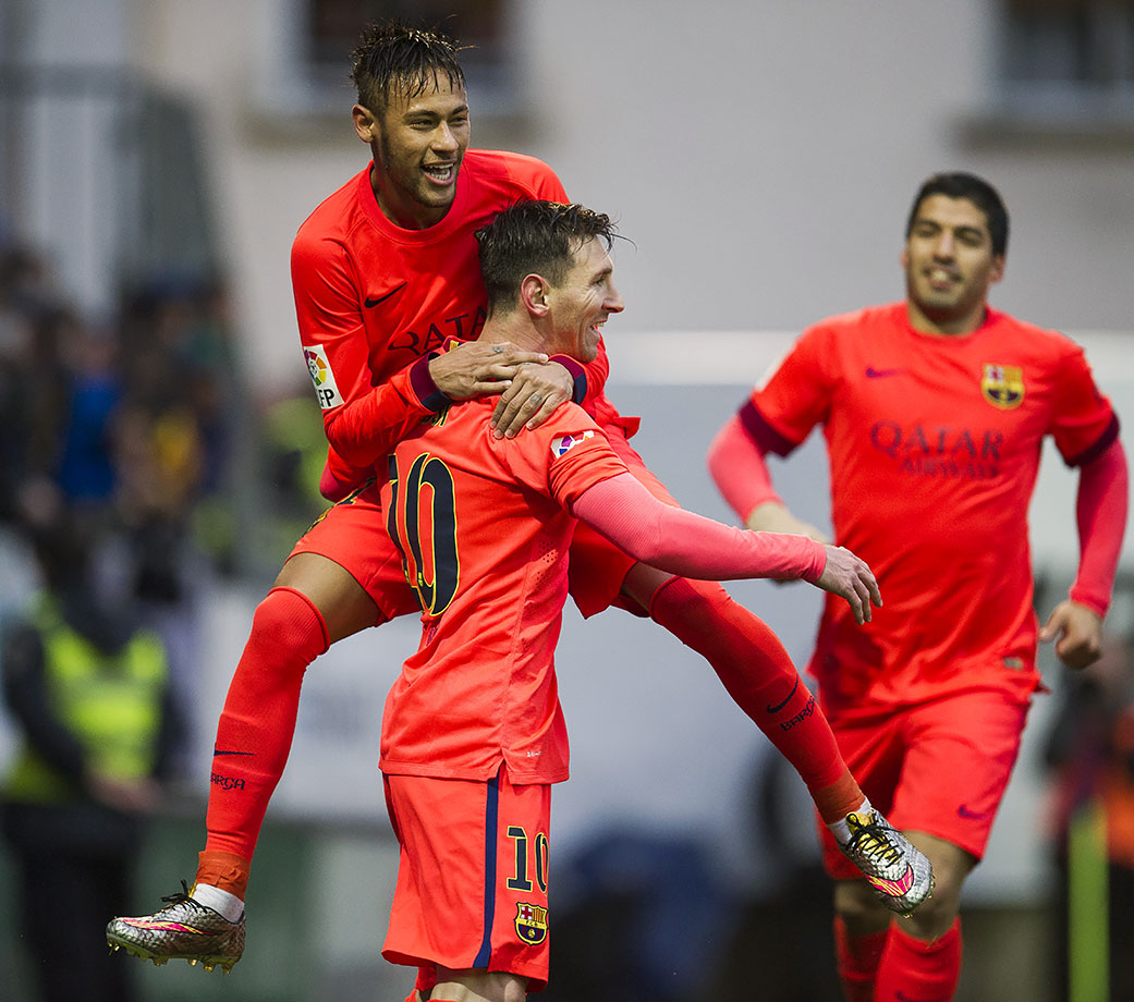 Neymar celebrates with teammate Lionel Messi after Messi scored during Barcelona's La Liga match against SD Eibar on March 14, 2015 at Ipurua Municipal Stadium in Eibar, Spain.