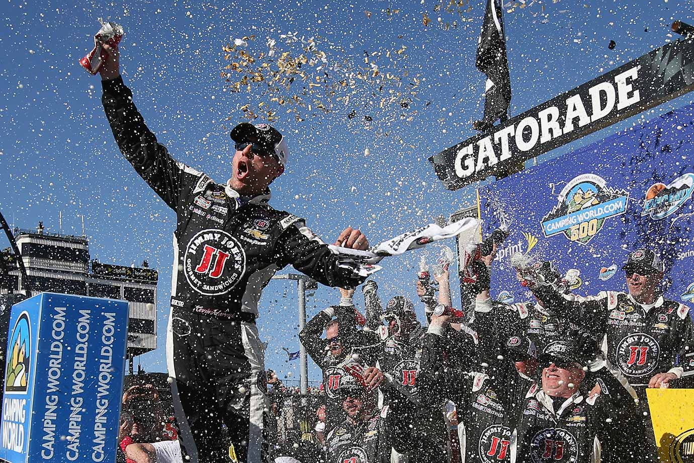Kevin Harvick celebrates in Victory Lane after winning the CampingWorld.com 500 race at Phoenix International Raceway on March 15, 2015.