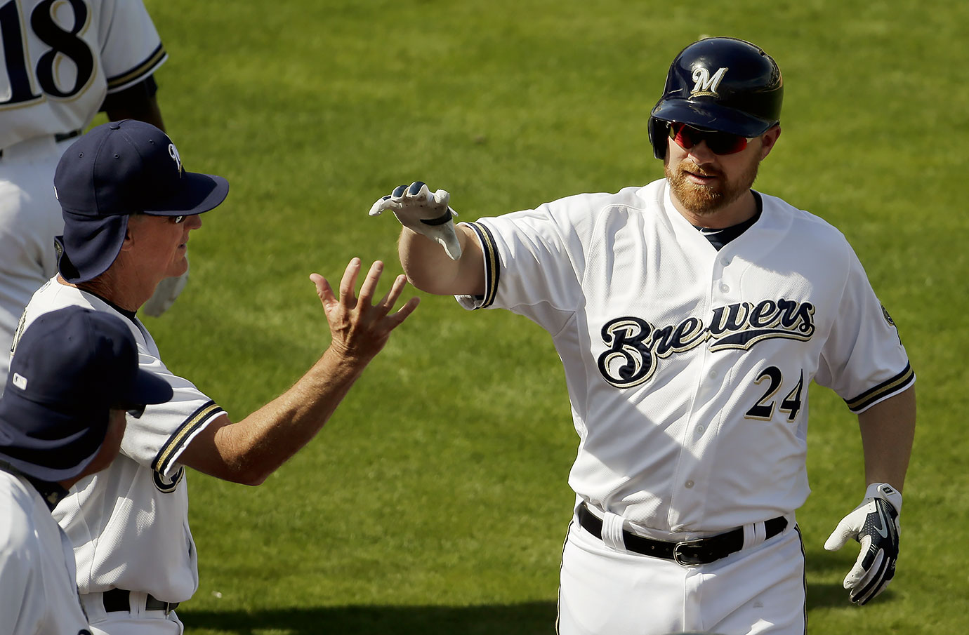 The Brewers banned high fives in an attempt to halt the spread of pinkeye in their clubhouse.