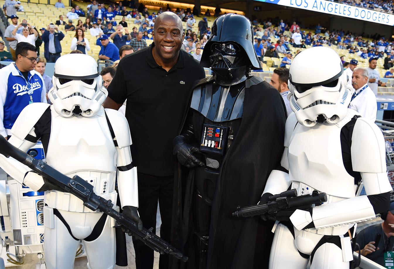 Magic Johnson poses with Darth Vader and stormtroopers before the Los Angeles Dodgers game against the Seattle Mariners on April 14, 2015 at Dodger Stadium in Los Angeles.