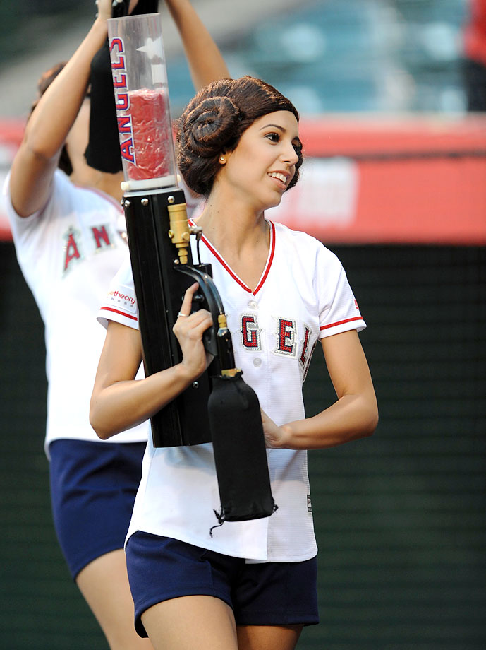 "Members of the Los Angeles Angels Strike Force wear Princess Leia hair on ""Star Wars Night"" during the Angels game against the Oakland Athletics on April 20, 2015 at Angel Stadium in Anaheim, Calif."