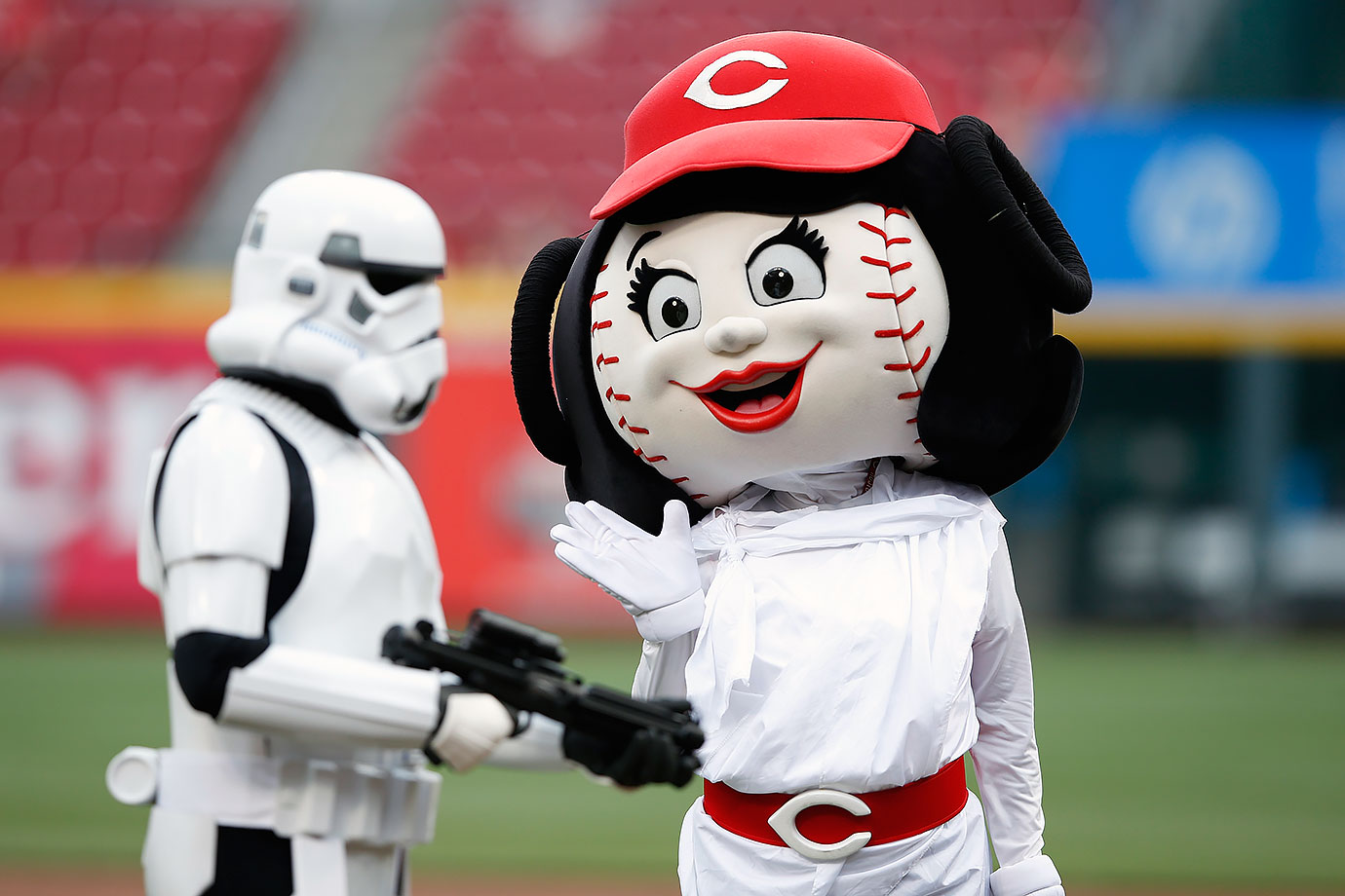 Cincinnati Reds mascot Rosie Red waves before the game against the San Francisco Giants on May 15, 2015 at Great American Ball Park in Cincinnati, Ohio.