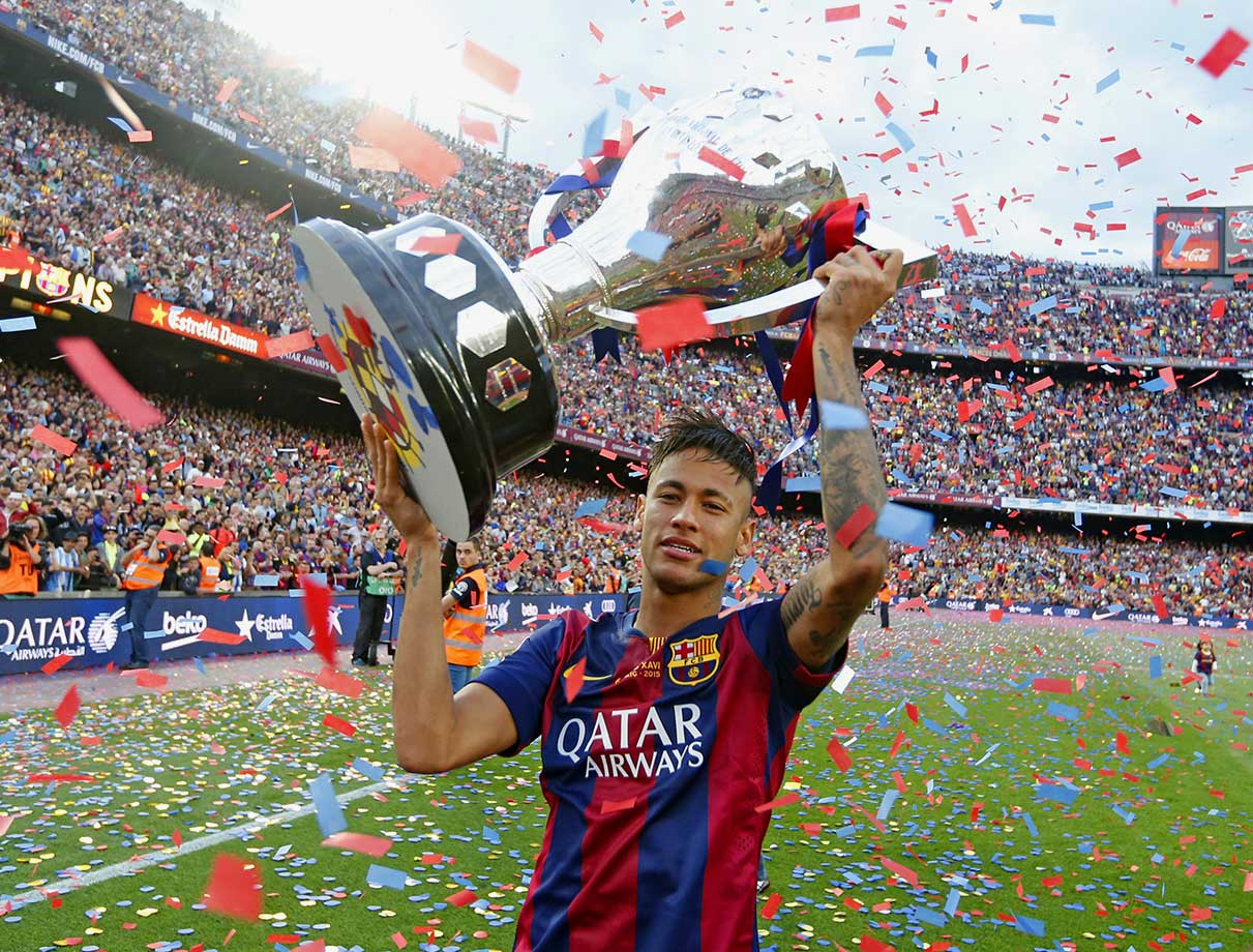 Neymar poses with La Liga trophy after Barcelona's match against Deportivo La Coruña on May 23, 2015 at Camp Nou in Barcelona, Spain.