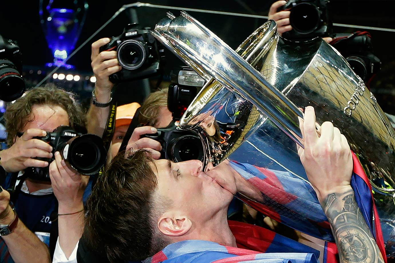 Barcelona's Lionel Messi kisses the trophy after the Champions League final match victory over Juventus F.C. on June 6, 2015 at the Olympiastadion in Berlin, Germany.