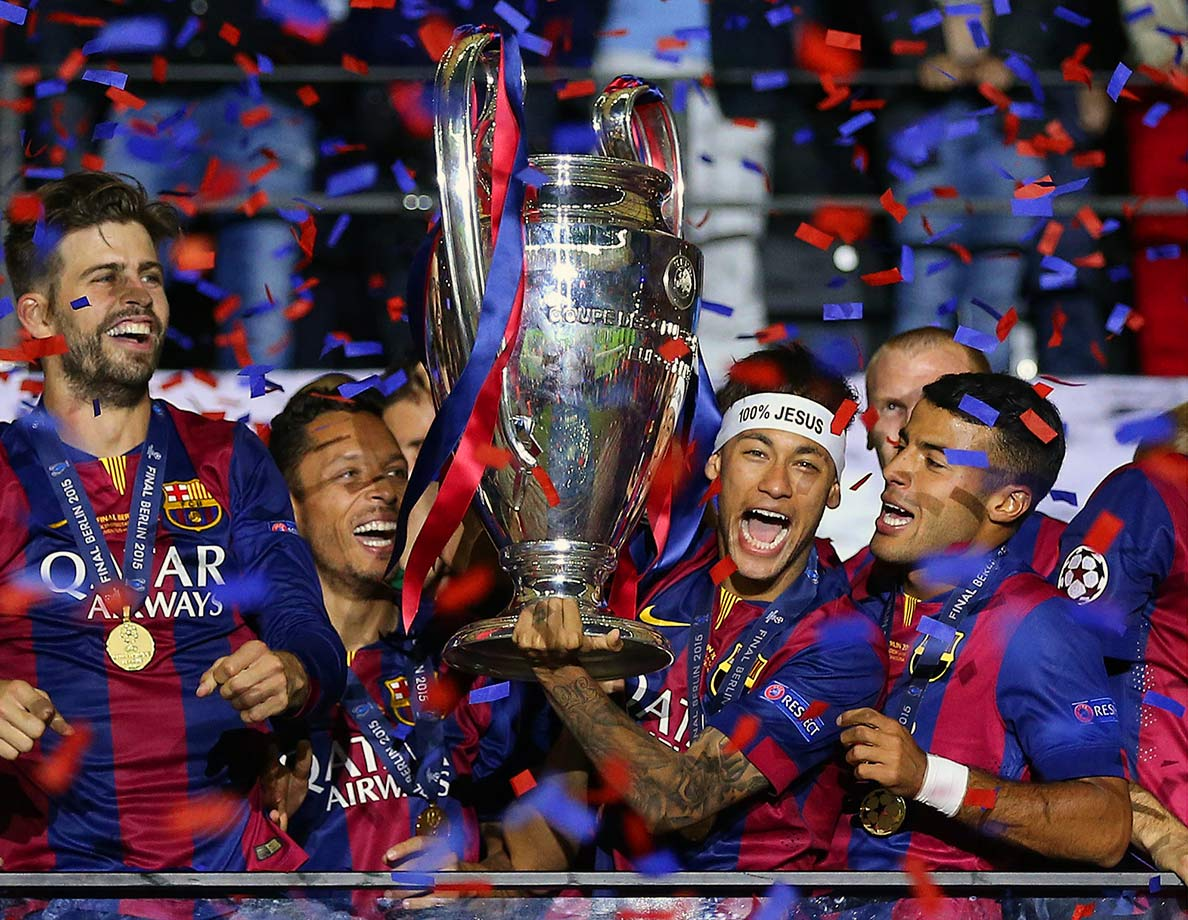 Neymar lifts the trophy following Barcelona's UEFA Champions League Final match against Juventus on June 6, 2015 at the Olympiastadion in Berlin, Germany.
