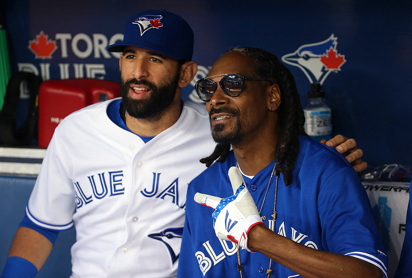 Snoop Dogg poses with Toronto Blue Jays right fielder Jose Bautista in the dugout before throwing out the first pitch for the Blue Jays game against the Miami Marlins on June 9, 2015 at Rogers Centre in Toronto.