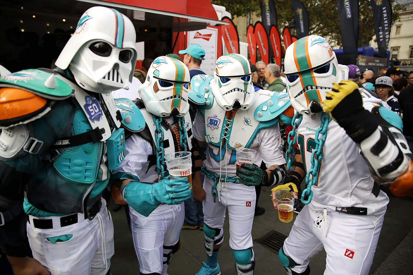 Miami Dolphins fans calling themselves the Fintroopers pose in their stormtrooper costumes during an NFL fan rally on Oct. 3, 2015 in Trafalgar Square prior to the game against the New York Jets at Wembley Stadium in London.