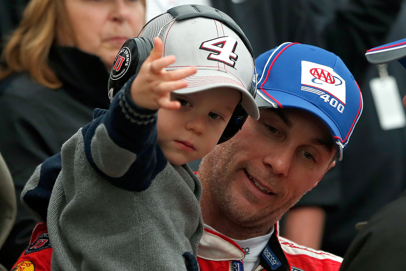 Kevin Harvick holds his son Keelan in Victory Lane after winning the AAA 400 race at Dover International Speedway on October 4, 2015.