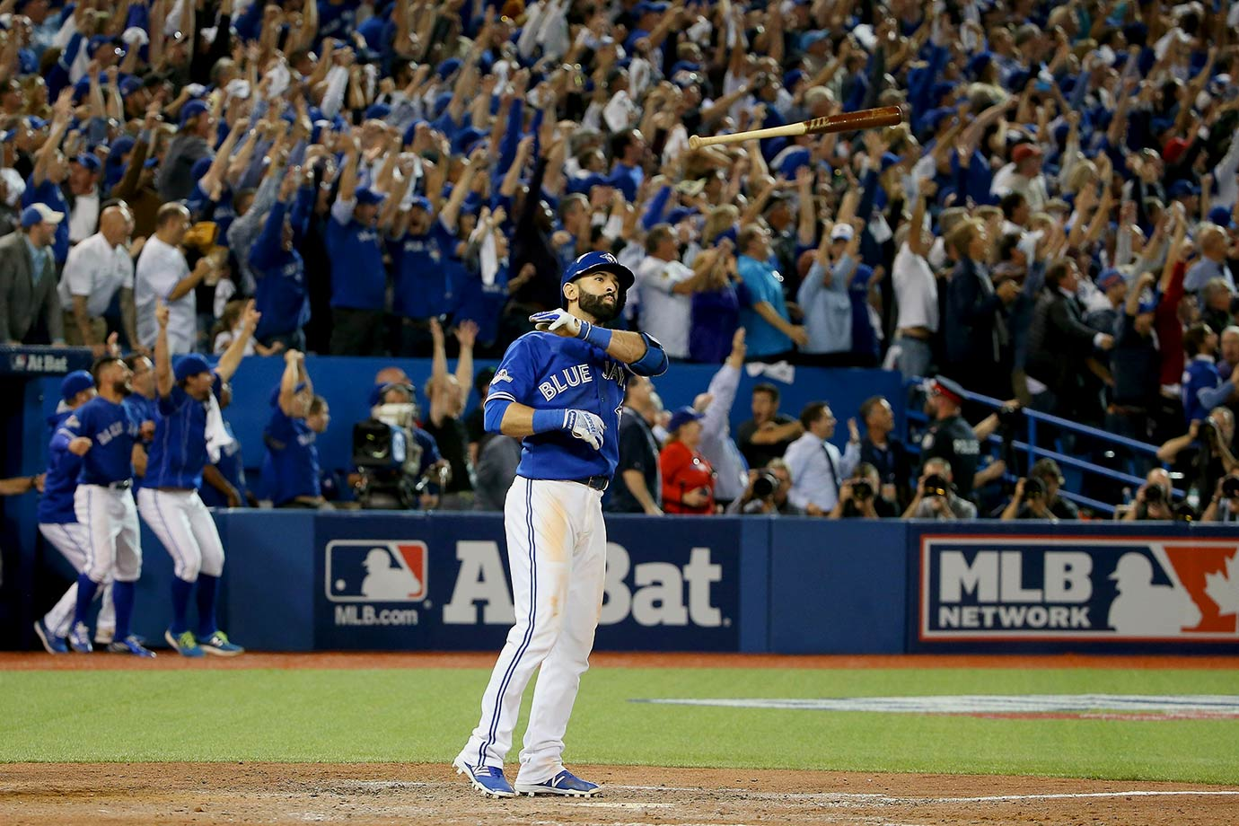 In Game 5 of the American League Division Series against the Texas Rangers, Jays catcher Russell Martin accidentally hit Shin-Soo Choo's bat while throwing the ball back to the pitcher – allowing a runner to score from third. While playing the game under protest, Bautista made it a moot point, after he crushed a three-run-home run to put Toronto ahead for good, sending them to its first championship series since 1993. But Bautista's bat flip became one for the ages, emphatically tossing his bat 10 yards away toward his dugout.