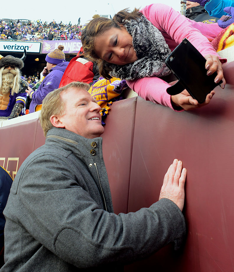 The one fan who actually wants a selfie with NFL commissioner Roger Goodell, or maybe she's just showing him a list of all of his recent mistakes.