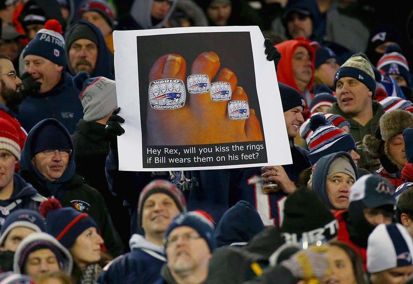 Props to these Patriots fans for working both New England's four Super Bowl victories and Rex Ryan's foot fetish into their sign.