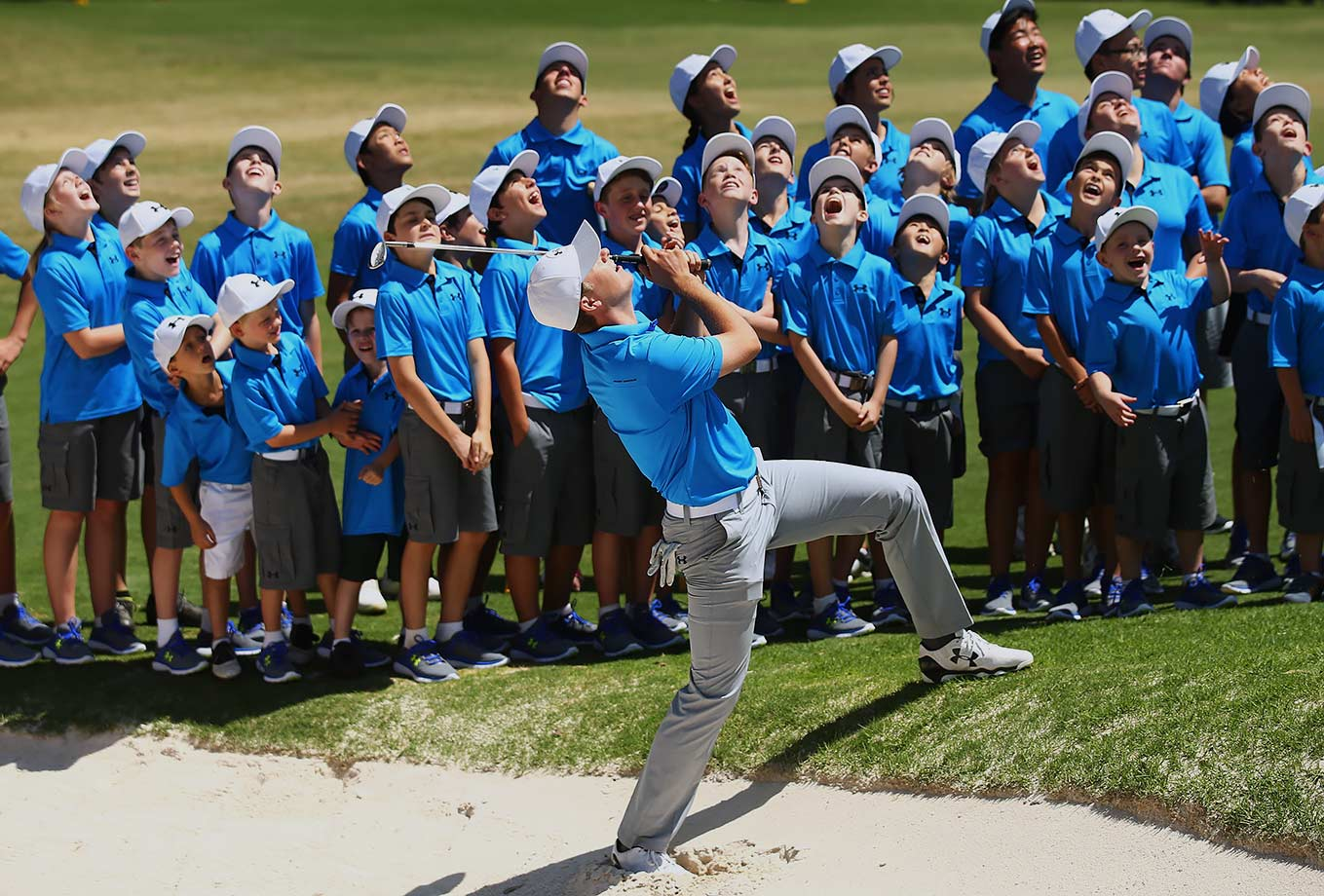 Based on where Jordan Spieth and the junior Australian golfers are looking at Spieth's bunker shot, they should probably all be running out of the way.
