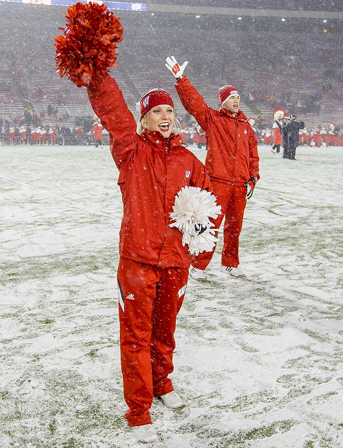 Wisconsin's cheerleaders were forced to flee the field at Camp Randall Stadium when they were pelted with snowballs by their own fans.