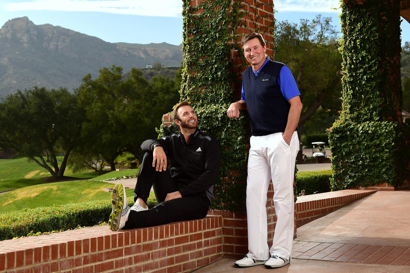 "Pro golfer Dustin Johnson looks up to his future father-in-law, Wayne Gretzky, during a photo shoot in Los Angeles on Jan. 9, 2015.  In ""The Great One,"" Johnson has a father figure who can teach him a thing or two about handling fame."