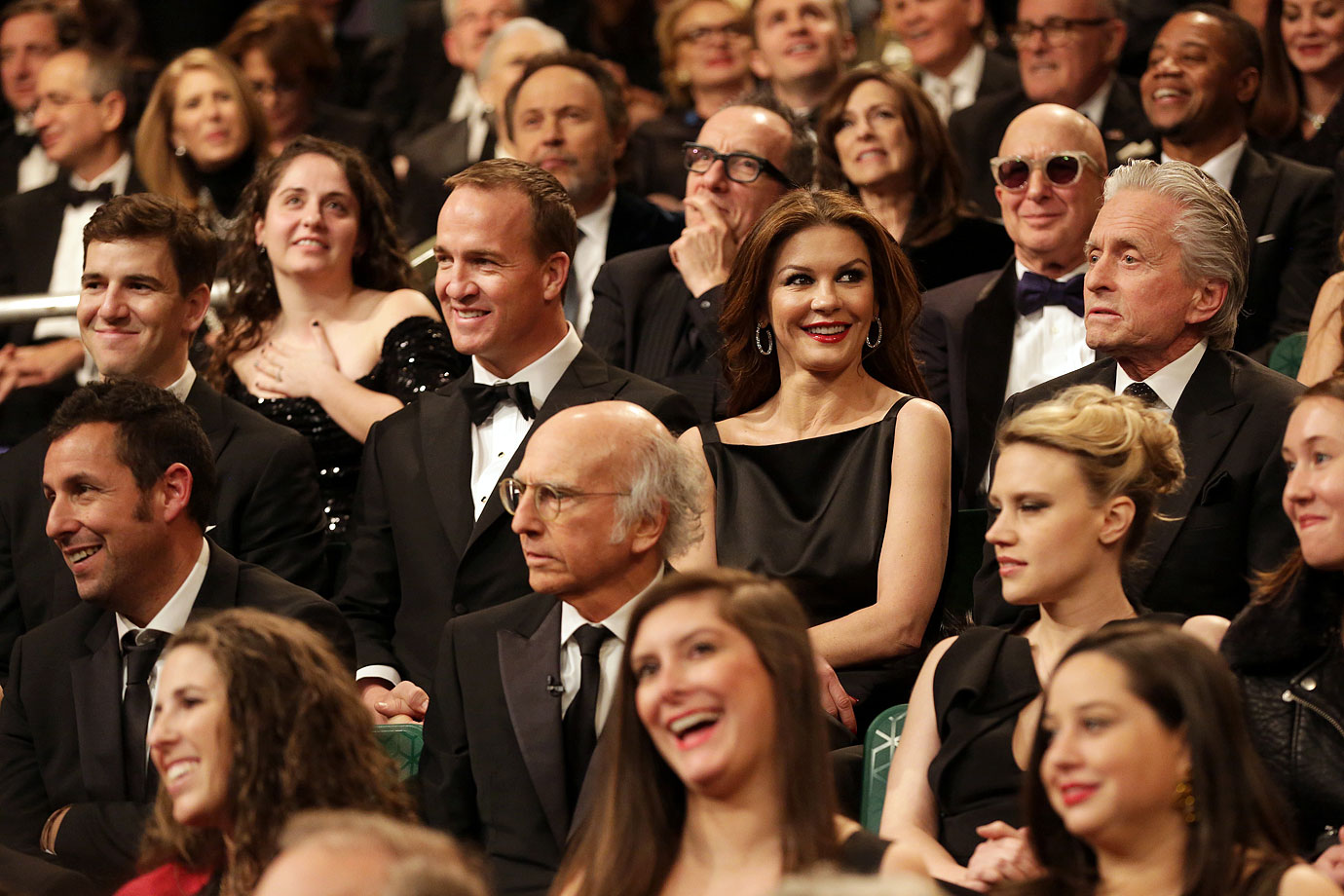 Eli and Peyton Manning smile alongside Catherine Zeta-Jones and Michael Douglas during the SNL 40th Anniversary Special's Audience Q&A in New York City.