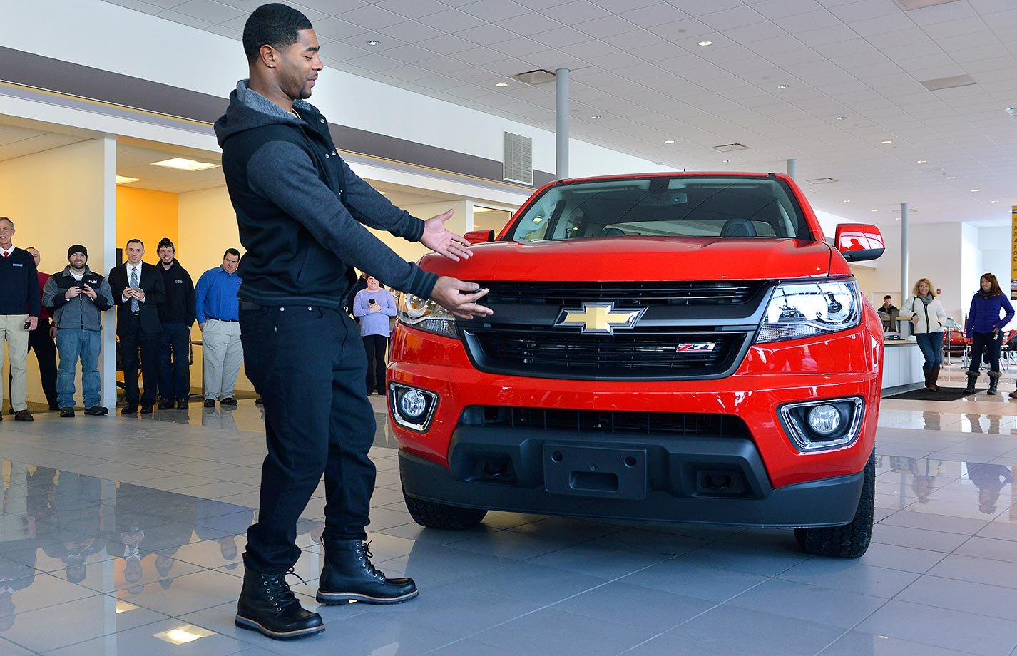 Malcolm Butler of the New England Patriots poses with his Chevrolet pickup.  The truck was intended to go to MVP Tom Brady, but Brady and the automaker determined that Butler should receive it in recognition for his game-saving interception that clinched the team's Super Bowl XLIX victory.