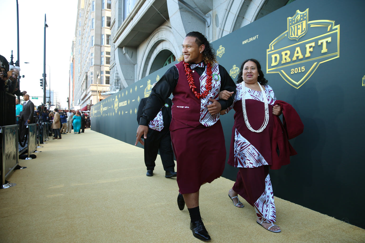 University of Washington nosetackle Danny Shelton takes a walk on the draft's gold carpet with his mother in their traditional Samoan gear. Shelton was selected by the Cleveland Browns with the 12th pick.