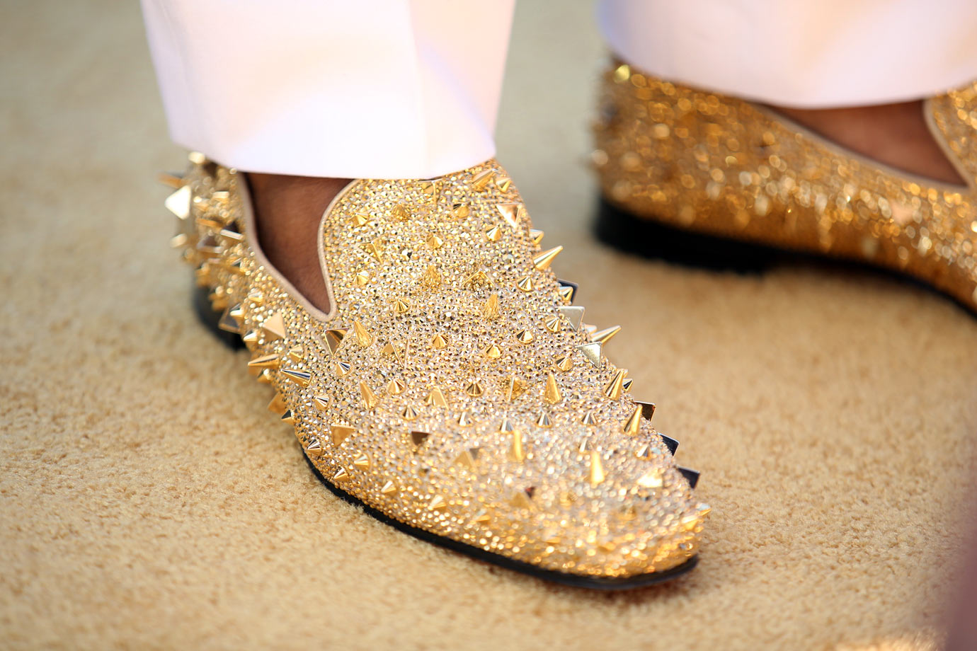 Florida defensive end Dante Fowler stepped into the NFL glittering in gold, wearing a $7,000 pair of Christian Louboutin loafers on draft day. Fowler was taken by the Jaguars with the third pick.