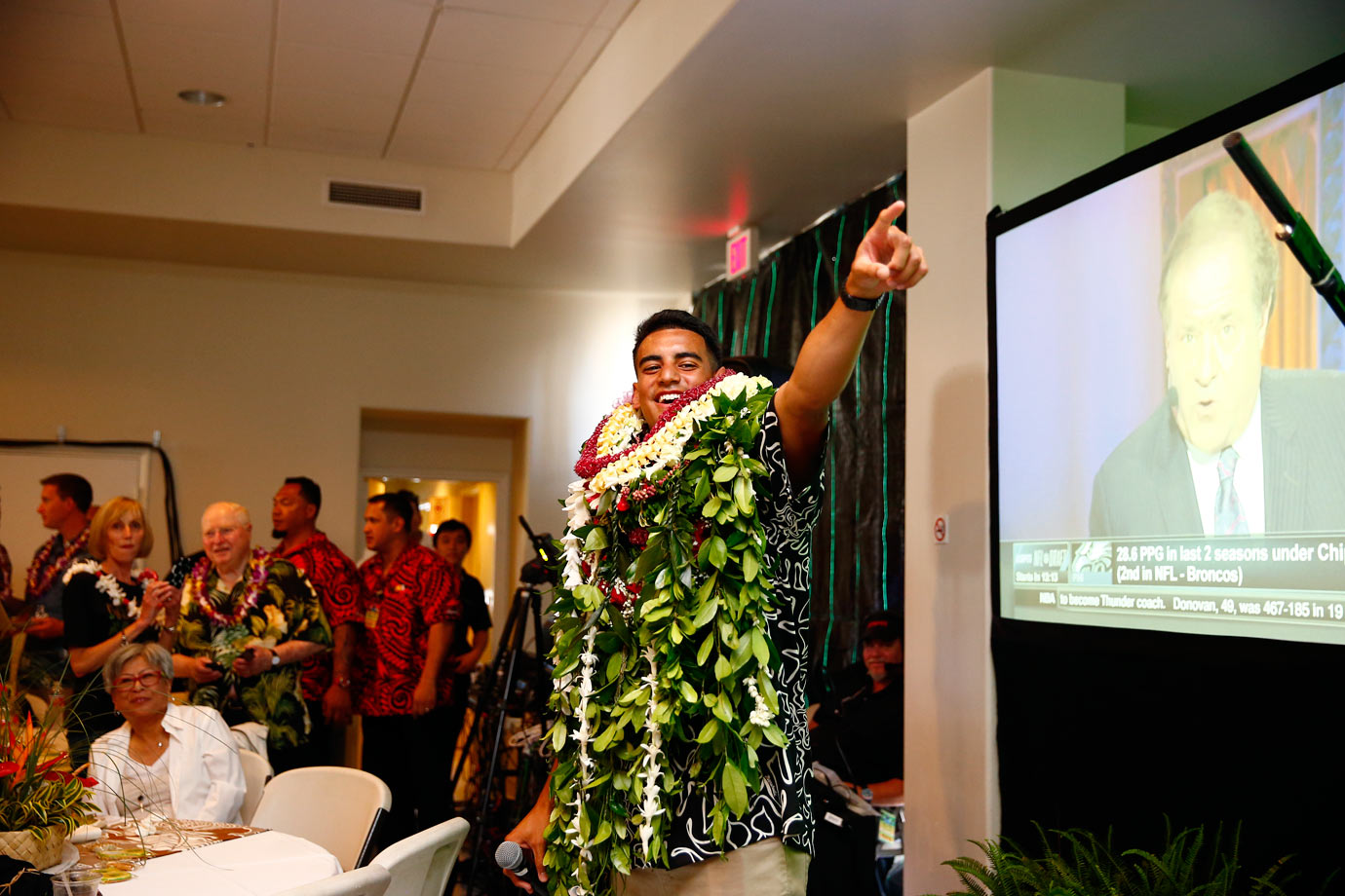 Laden with leis, Marcus Mariota celebrates being drafted by the Titans at No. 2 with family and friends in his native Honolulu.