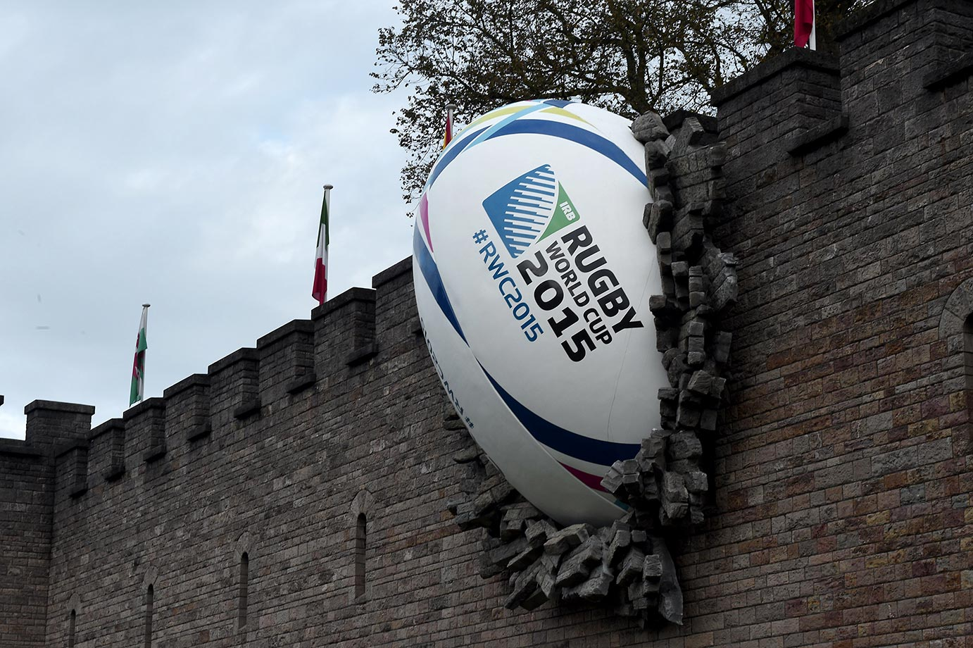 A giant rugby ball breaking through the wall of Cardiff castle before the start of the 2015 Rugby Union World Cup.