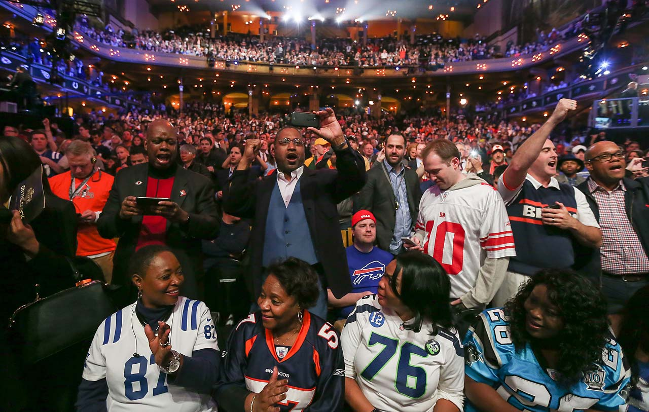 Fans cheer after Kevin White of the West Virginia Mountaineers was picked seventh by the Chicago Bears.
