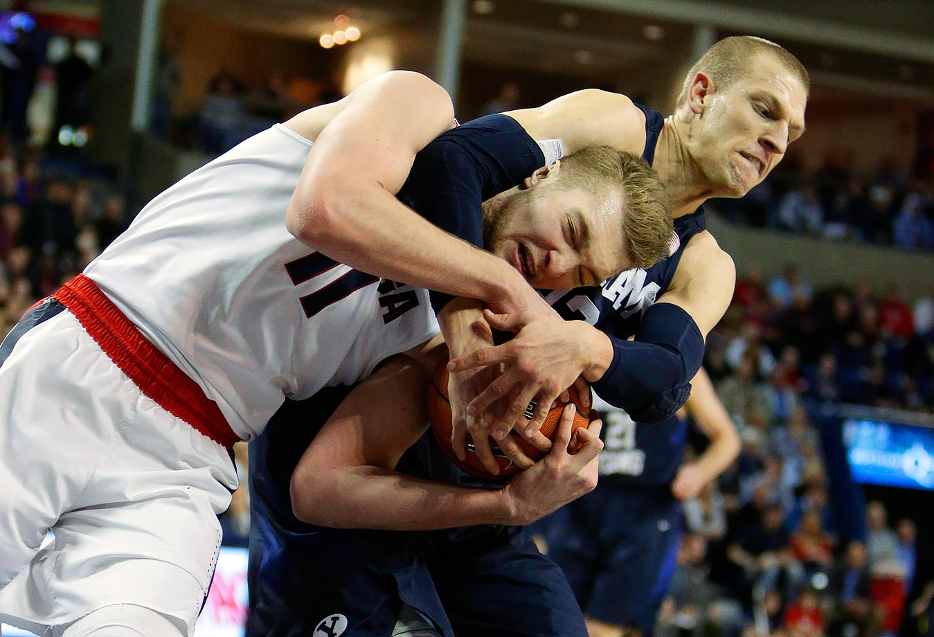 Gonzaga's Domantas Sabonis and BYU's Nate Austin fight for a rebound. Sabonis needs to watch out for a noogie.