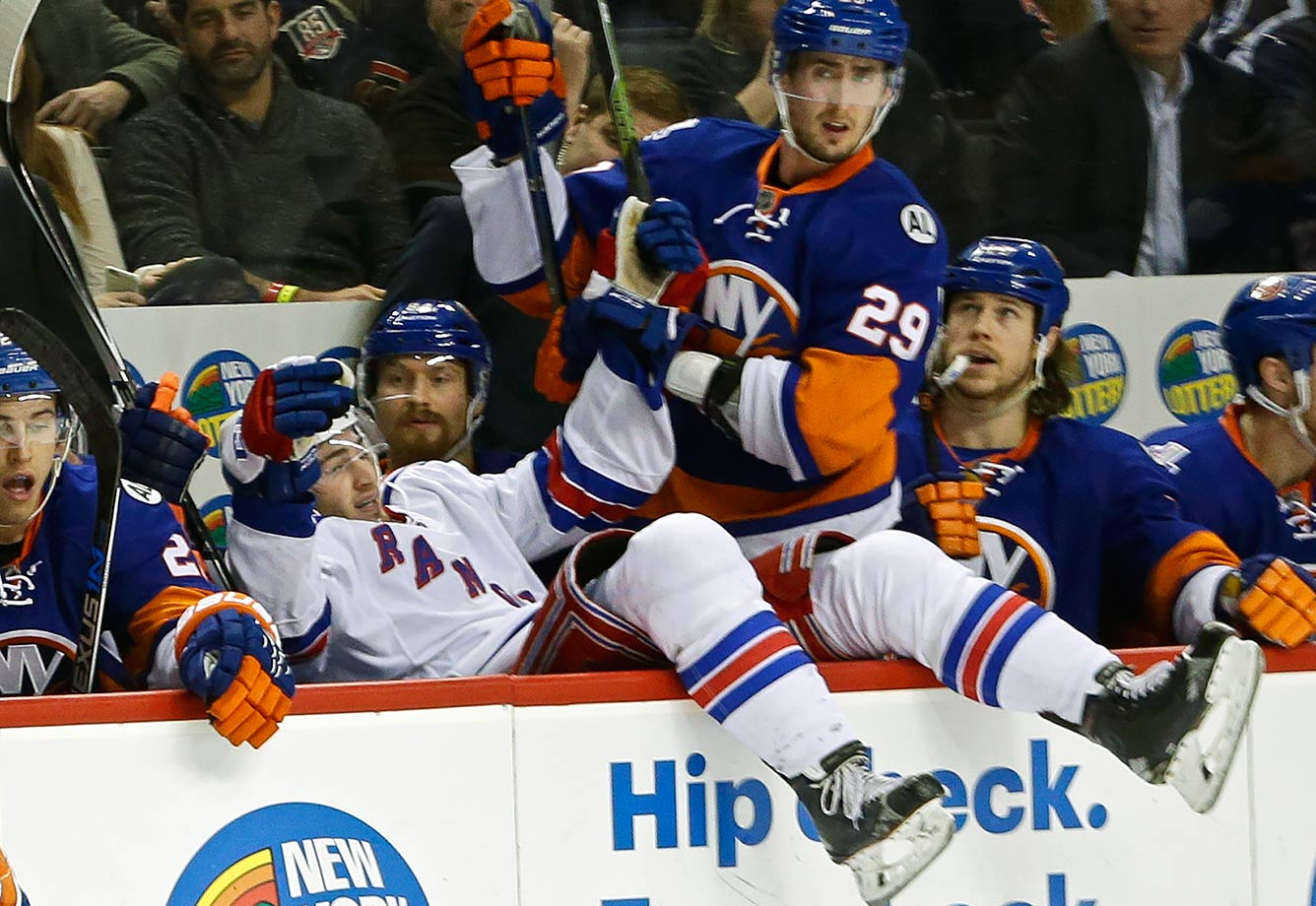 New York Islanders left wing Brock Nelson cannot be bothered by New York Rangers center Jayson Megna falling into the Isles' bench.