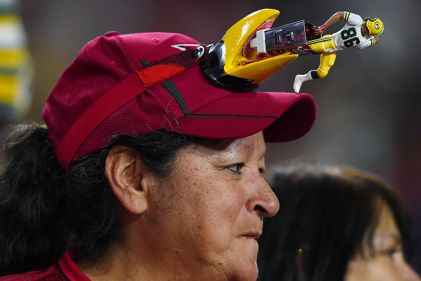 This Arizona Cardinals fan sports an interesting hat during the NFC divisional playoff game against the Green Bay Packers.
