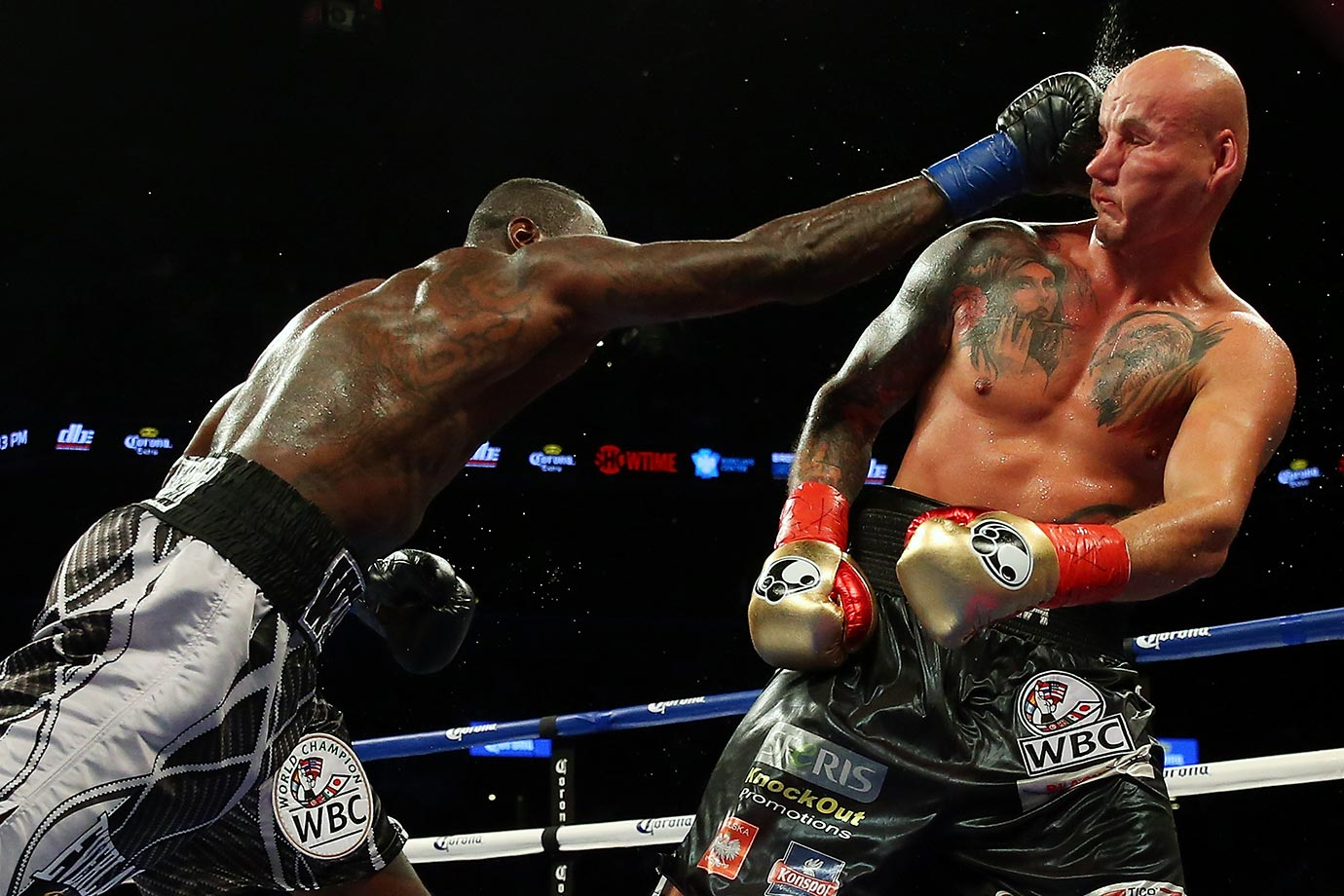 Deontay Wilder punches Artur Szpilka during their WBC Heavyweight Championship bout at Barclays Center in Brooklyn.