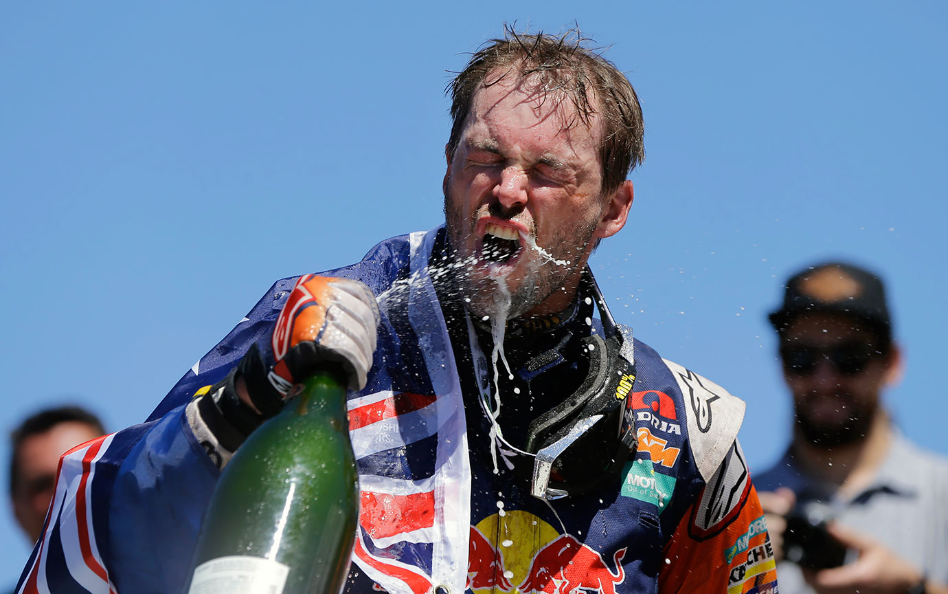 Australian motorbike rider Toby Price shows pretty good aim as he sprays sparkling wine into his mouth after winning the 2016 Dakar Rally in Argentina.
